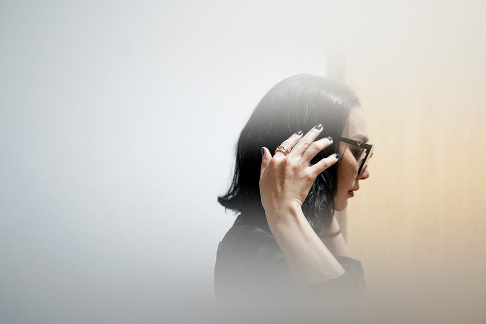 In this photo taken through frosted glass, Burmaa Oyubchineg, cousin of the murdered Mongolian model Altantuya Shaariibuu, arrives at Shah Alam High Court in Shah Alam, Malaysia, Wednesday, Jan. 23, 2019. (AP Photo/Yam G-Jun)