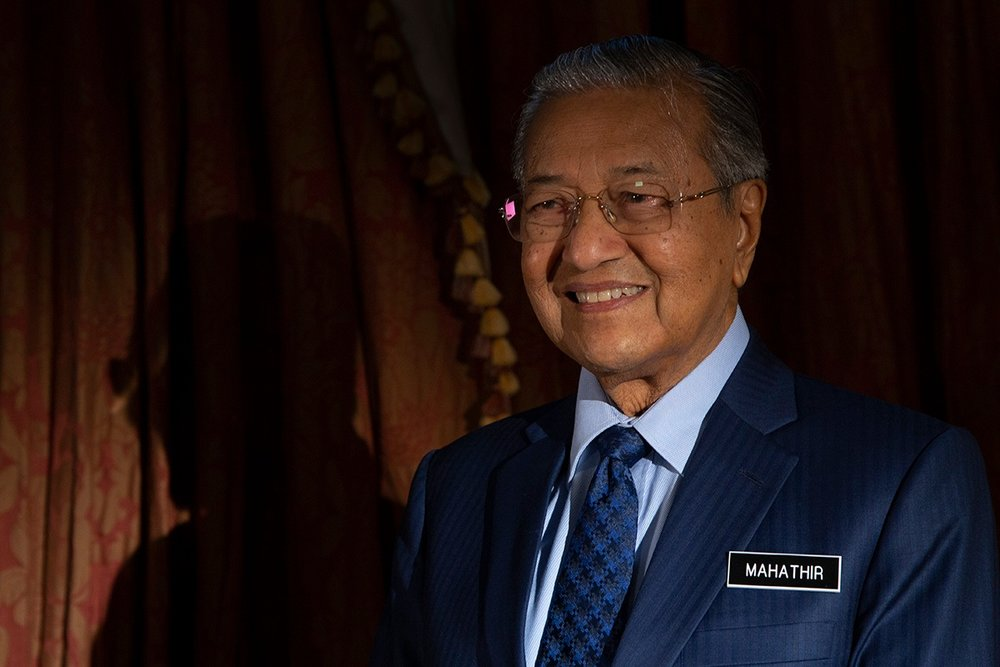 Malaysia's Prime Minister Mahathir Mohamad poses for a portrait after an interview with The Associated Press in Putrajaya, Malaysia, Monday, Aug. 13, 2018. (AP Photo/Yam G-Jun)