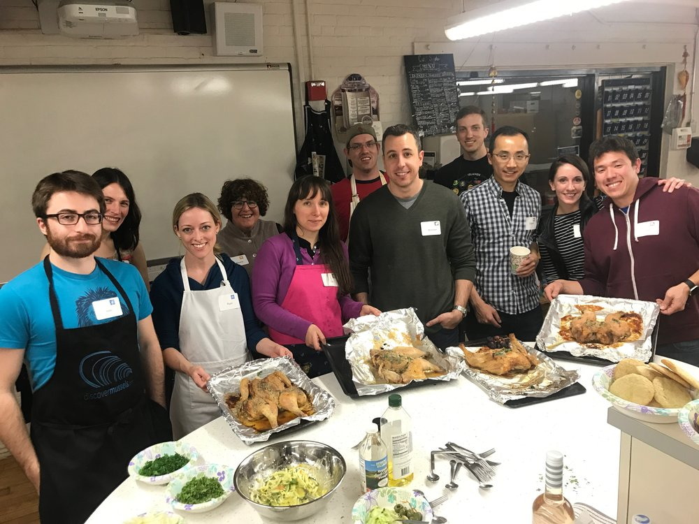 Group of cooking class students serving all the food Jacqueline Church taught them to make. Roast chicken, citrus compound butter, and shaved fennel with vinaigrette.
