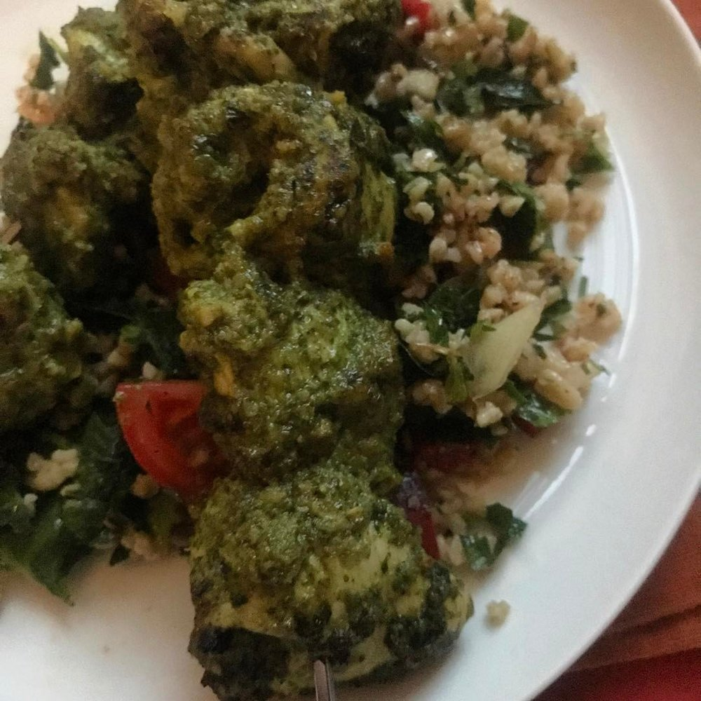 "Marinated chicken in ""cilantro shrug"" served over freekeh tabbouleh."