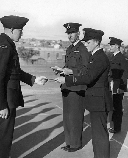 Squadron Leader F.C. Penny (centre) at presentation of proficiency certificates to RAAF Air Training Corps cadets, c1942. (Photograph Argus Newspaper Collection of Photographs, State Library of Victoria.)