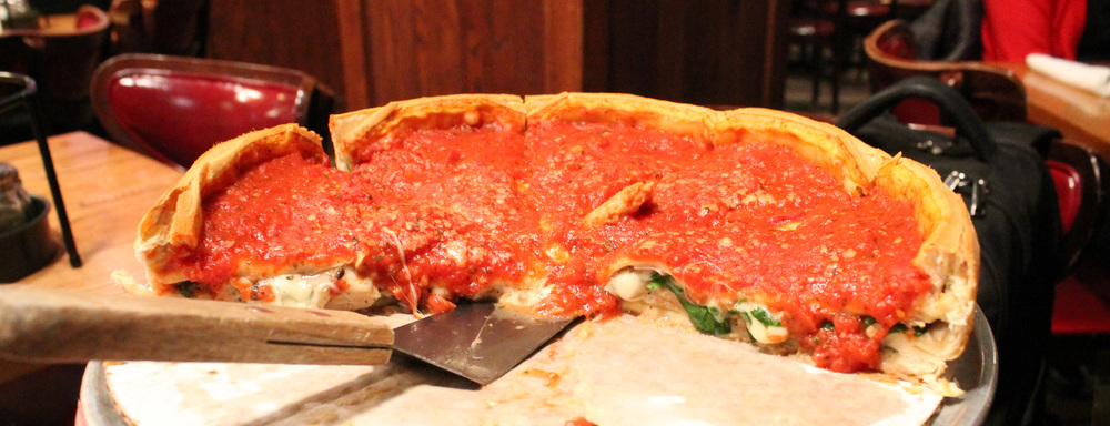 Look at that depth! Worth the wait for this  Chicken Sausage Deluxe deep dish pizza w/ mushrooms &   spinach  .