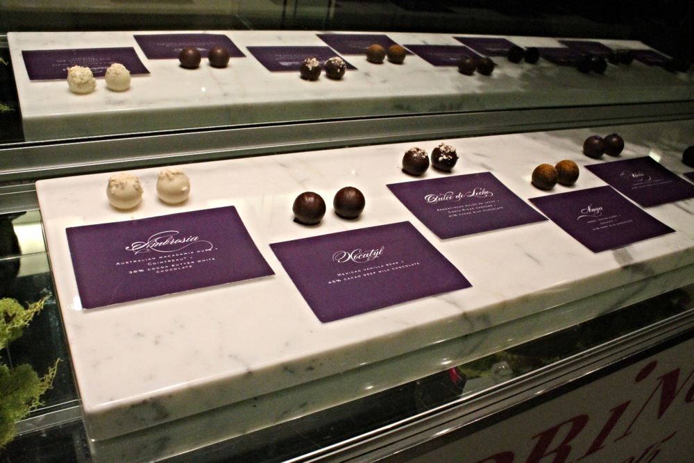 "Pronounced like ""vogue"" except the G-sound is a soft vibrating J-sound (did that make any sense?), Vosges is super duper fancy where they display their truffles under a glass case as if they were jewelry."