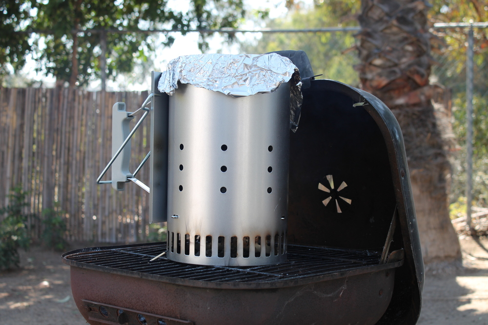 Used this  rapidfire chimney starter  to get my charcoals going for the grill. I found that placing a sheet of aluminum foil on top as a lid helped expedite the process.