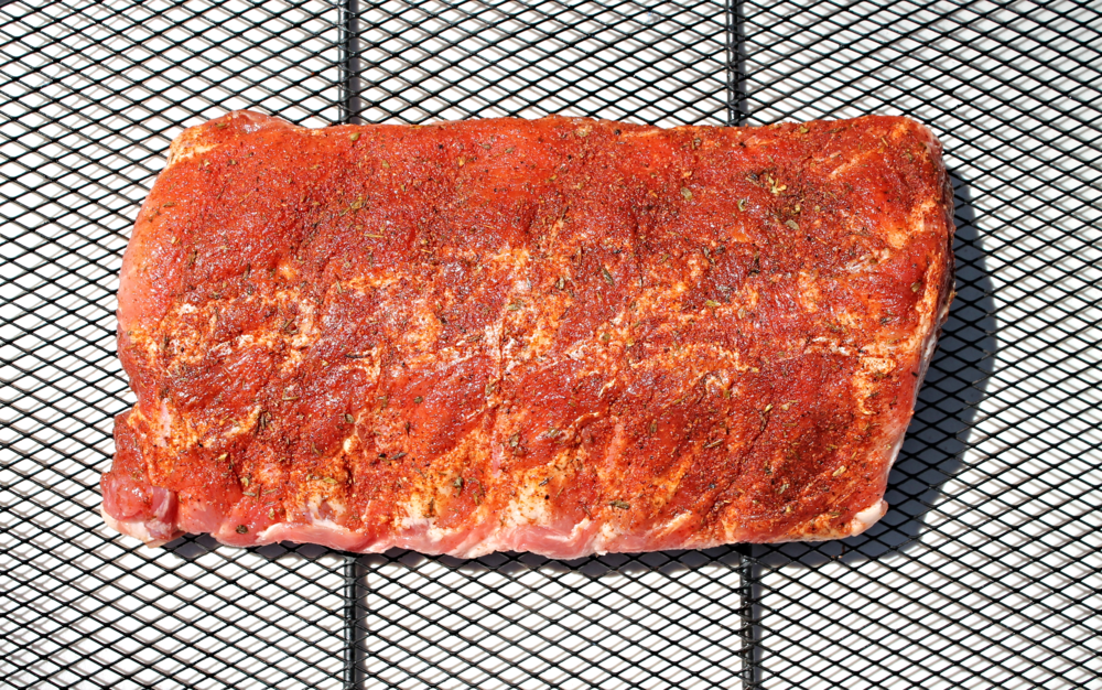 After 24 hours  in the fridge of dry marinading in  Emeril's   dry rub recipe , the ribs prepare to meet the heat.