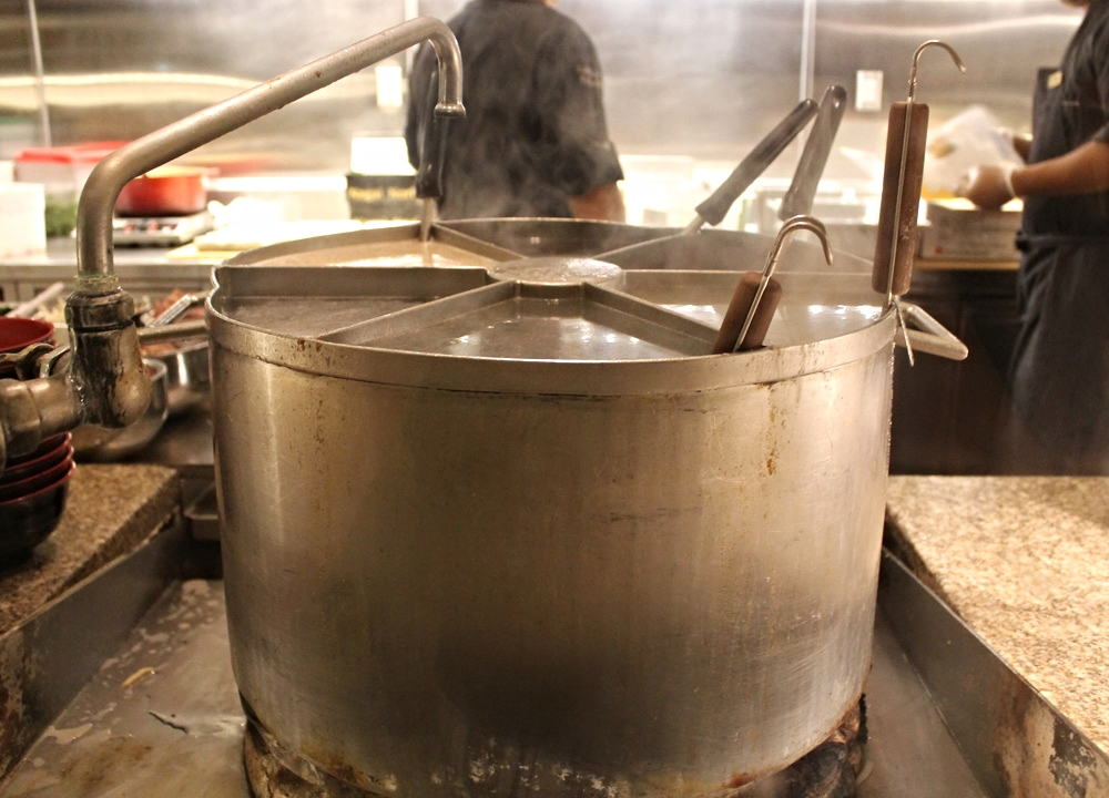 Where the broth happens: blazing hot pot of flavored liquids for Asian noodles.