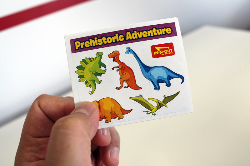 After ordering and sitting down, Rodolfo handed out a freebie of stickers. Why In-N-Out chose dinosaurs instead of  Victoria's Secret models I'll never understand.