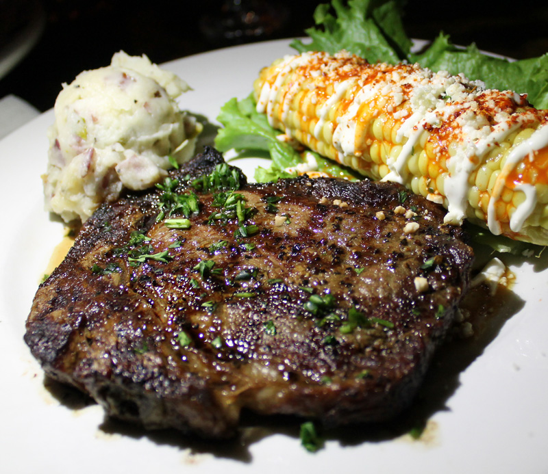 My juicy steak cooked to my liking, bacon + green onion mashed taters,and my first-ever elote (Mexican-style corn).