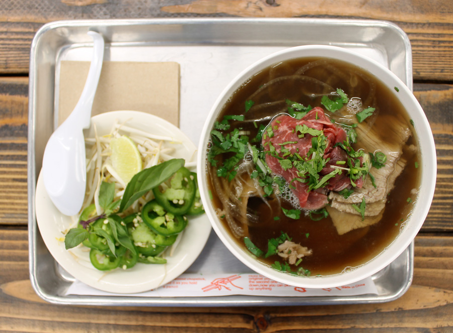 WASHUGYU BEEF PHO  —  rare american wagyu steak & beef brisket w/  bean sprouts, limes, thai basil, and a handful of jalapeño slices.