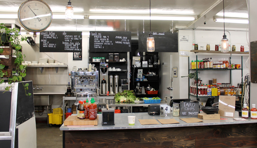 In a rustically minimal setting, the kitchen and prep areas are visible from the tip jar.