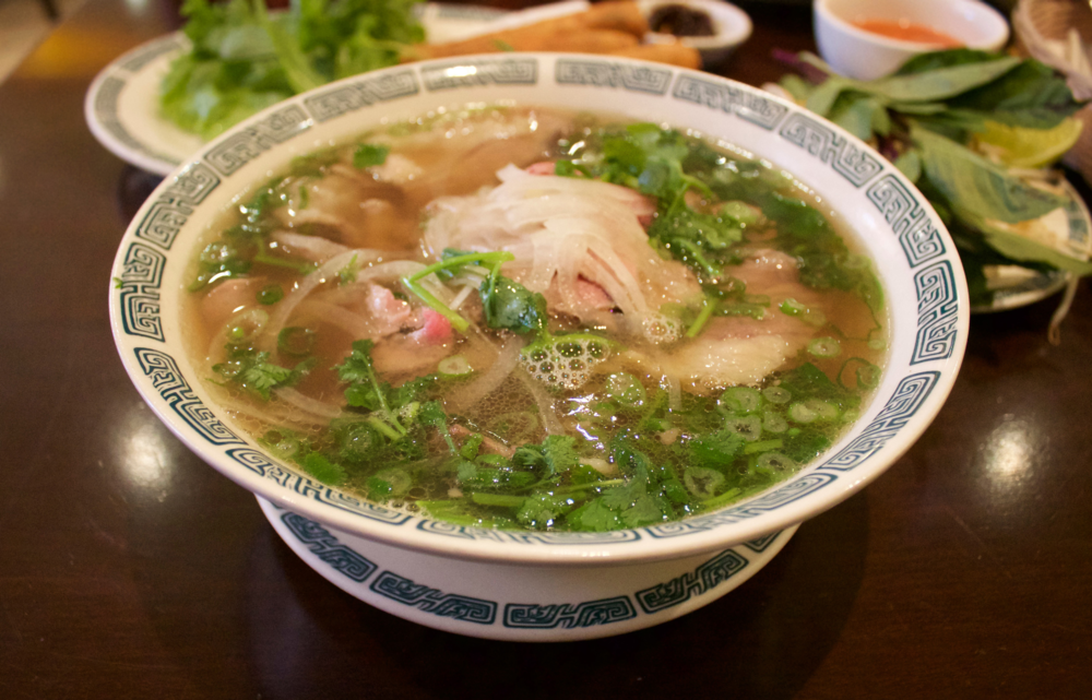 "TAI GAU  —   bowl of pho (pronounced ""fuh"") with   rare steak and fatty brisket."