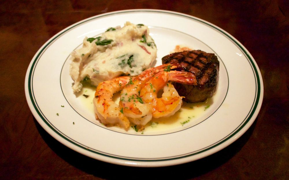 SURF & TURF  —  filet and grilled shrimp with a side of spinach mashed potatoes.