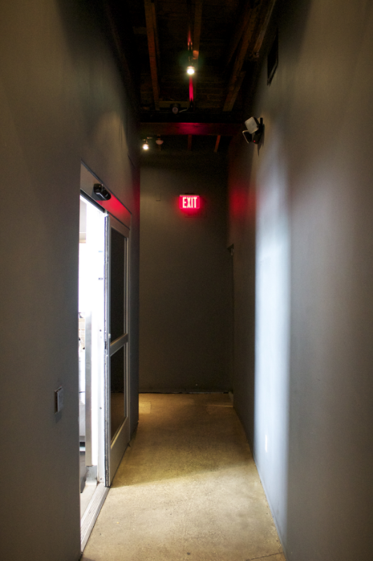 Thanks for the receipt, sir, but... where do I sit? Oh, I just turn here... into this dark hallway... and walk towards that ominous EXIT sign...