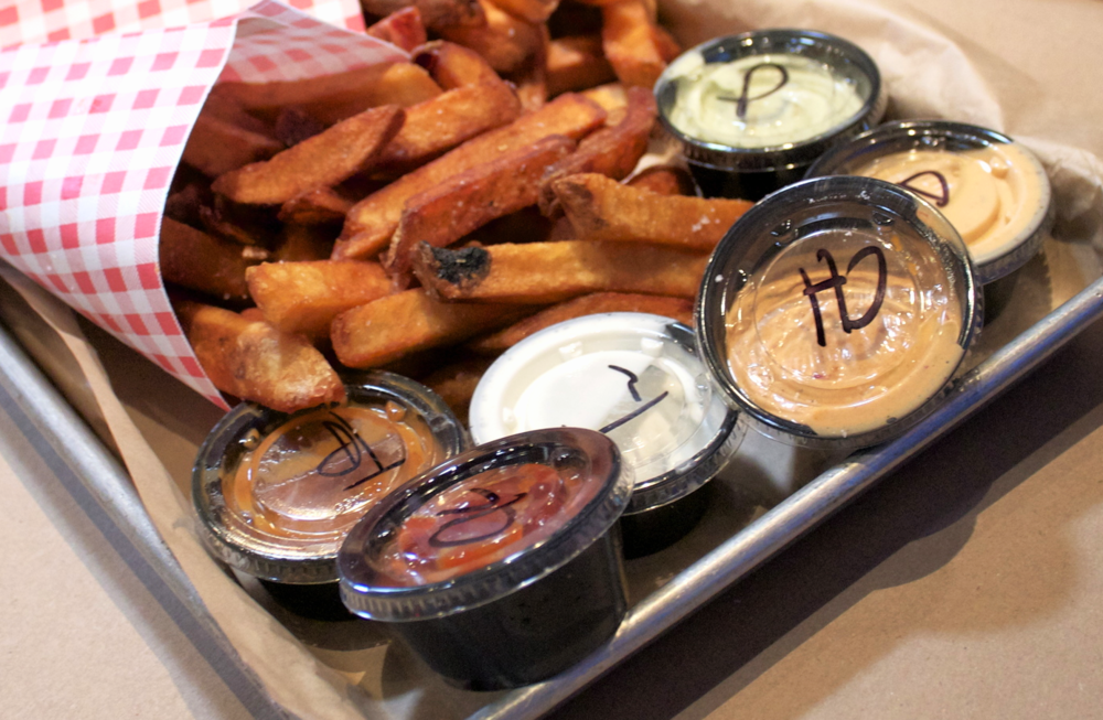 Golden, thick, and crispy fries with the variety of sauces. Most of the sauces paired well, but I also did some dipping with the complimentary mustards.