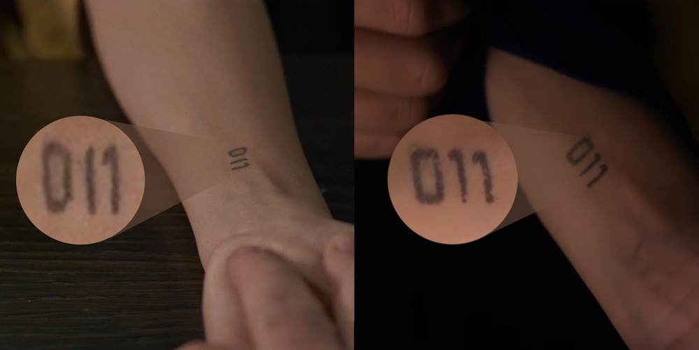 Above are two enhanced views of Eleven's tattoo — on the left (El showing to Benny) the 1's look different from each other, right? To me, it looks more like 0I1, or zero / capital i / one. But on the right (El showing to the boys) the 1's in Eleven's tattoo actually look like 1's. My guess: El's tattoo artist used magic ink from   Hogsmeade  .