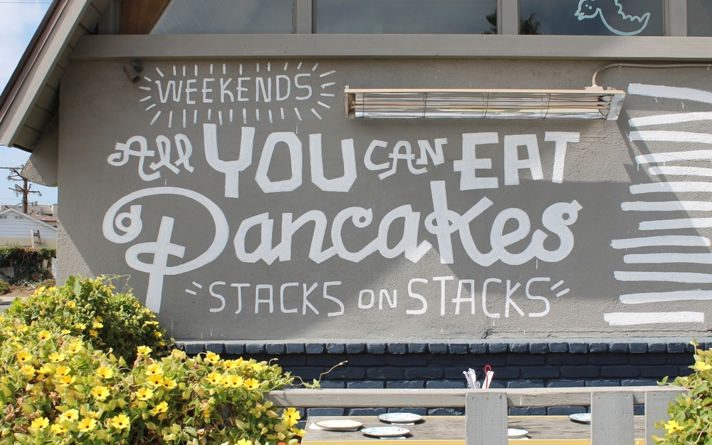 Prominently advertised on the street-facing exterior, A-Frame aims to please pancake lovers. Their pancake special features 5 types of pancakes: Buttermilk, Lilikoi Butter, Banana Mac Nut, P.O.G., and Buttermilk Chicken.