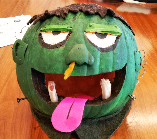 """Mmm...Boogers"" made with nails, screws, paints, wires, felt, and pork ribs for the teeth."