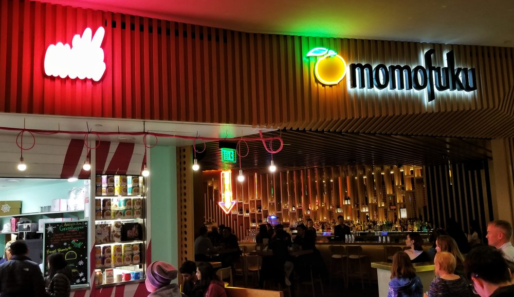 Friendly Neighbors  — The facade of Momofuku showcases the Peach Bar, which is open from 3-5:30 during its Social Hour. Next door is  Milk Bar,  a delightful dessert and bakery shop created by chef  Christina Tosi , which is also part of the Momofuku restaurant group.