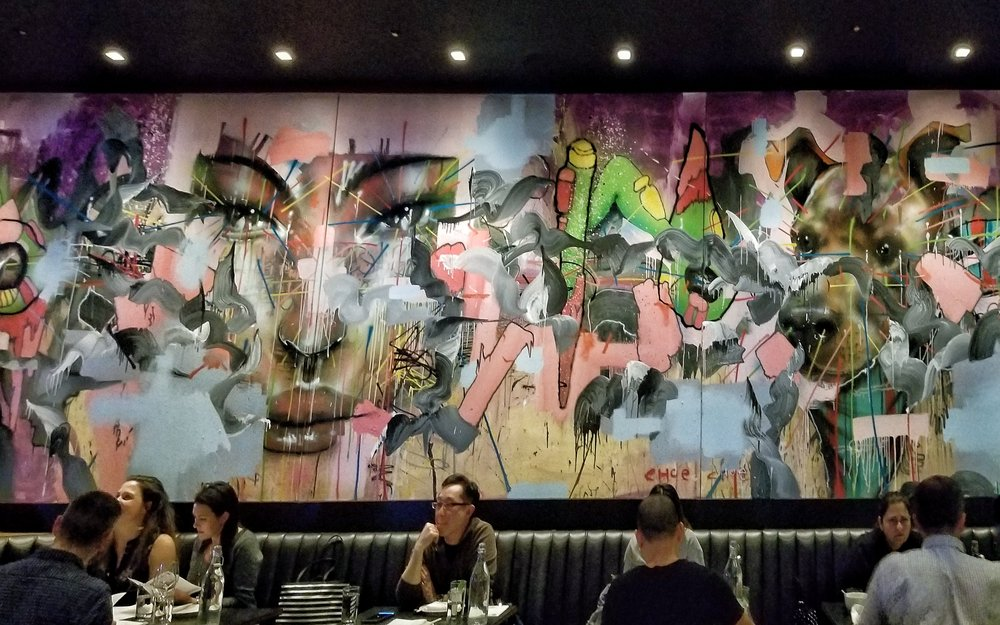 Art of David Choe  — once inside the dining room, you cannot help but see a giant 5-panel mural created by artist  David Choe .
