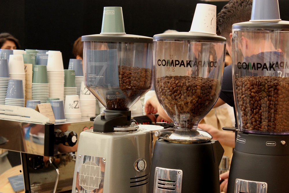 Compak and Mazzer grinders stand side by side