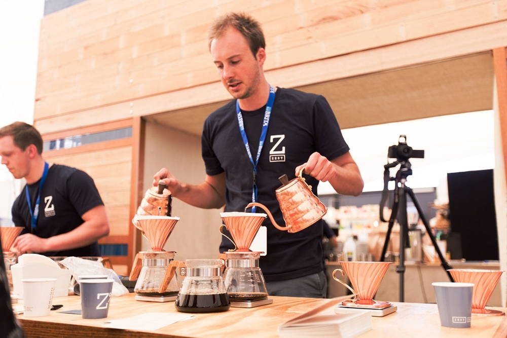 Rob McDonald pours two filter brews using Hario copper kettles and V60's