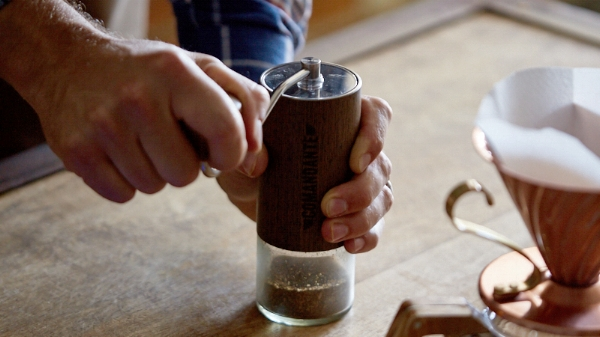 Grinding using the Comadante Hand Grinder.