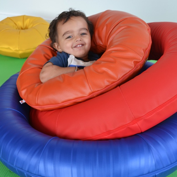 Boy lounging in a set of O-Rings