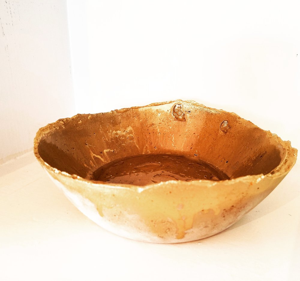 Gold dipped cement bowl