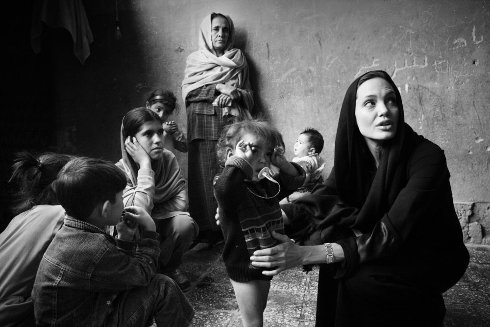 Taken by  Marco Di Laur o during Angelina's trip to Afghanistan