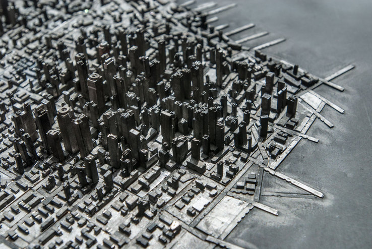 Type City     Literally a miniature city build with metal type by  Hong Seon Jang . Amazing.    (via  Quipsologies )