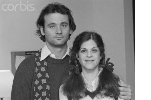 """oldloves: Bill Murray on Gilda Radner: """"Gilda got married and went away. None of us saw her anymore. There was one good thing: Laraine had a party one night, a great party at her house. And I ended up being the disk jockey. She just had forty-fives, and not that many, so you really had to work the music end of it. There was a collection of like the funniest people in the world at this party. Somehow Sam Kinison sticks in my brain. The whole Monty Python group was there, most of us from the show, a lot of other funny people, and Gilda. Gilda showed up and she'd already had cancer and gone into remission and then had it again, I guess. Anyway she was slim. We hadn't seen her in a long time. And she started doing, """"I've got to go,"""" and she was just going to leave, and I was like, """"Going to leave?"""" It felt like she was going to really leave forever. So we started carrying her around, in a way that we could only do with her. We carried her up and down the stairs, around the house, repeatedly, for a long time, until I was exhausted. Then Danny did it for a while. Then I did it again. We just kept carrying her; we did it in teams. We kept carrying her around, but like upside down, every which way—over your shoulder and under your arm, carrying her like luggage. And that went on for more than an hour—maybe an hour and a half—just carrying her around and saying, """"She's leaving! This could be it! Now come on, this could be the last time we see her. Gilda's leaving, and remember that she was very sick—hello?"""" We worked all aspects of it, but it started with just, """"She's leaving, I don't know if you've said good-bye to her."""" And we said good-bye to the same people ten, twenty times, you know. And because these people were really funny, every person we'd drag her up to would just do like five minutes on her, with Gilda upside down in this sort of tortured position, which she absolutely loved. She was laughing so hard we could have lost her right then and there. It was just one o"""