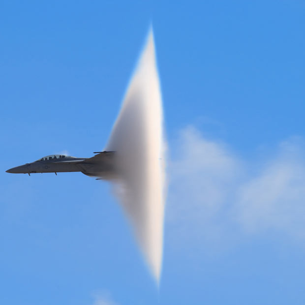 inothernews: DON'T MACH ME   An F-18 Super Hornet passes through the sound barrier, creating a visible 'vapour cone' above the Miramar Air Station in San Diego, California.  (Photo: Steve Skinner / Solent News via the Telegraph)