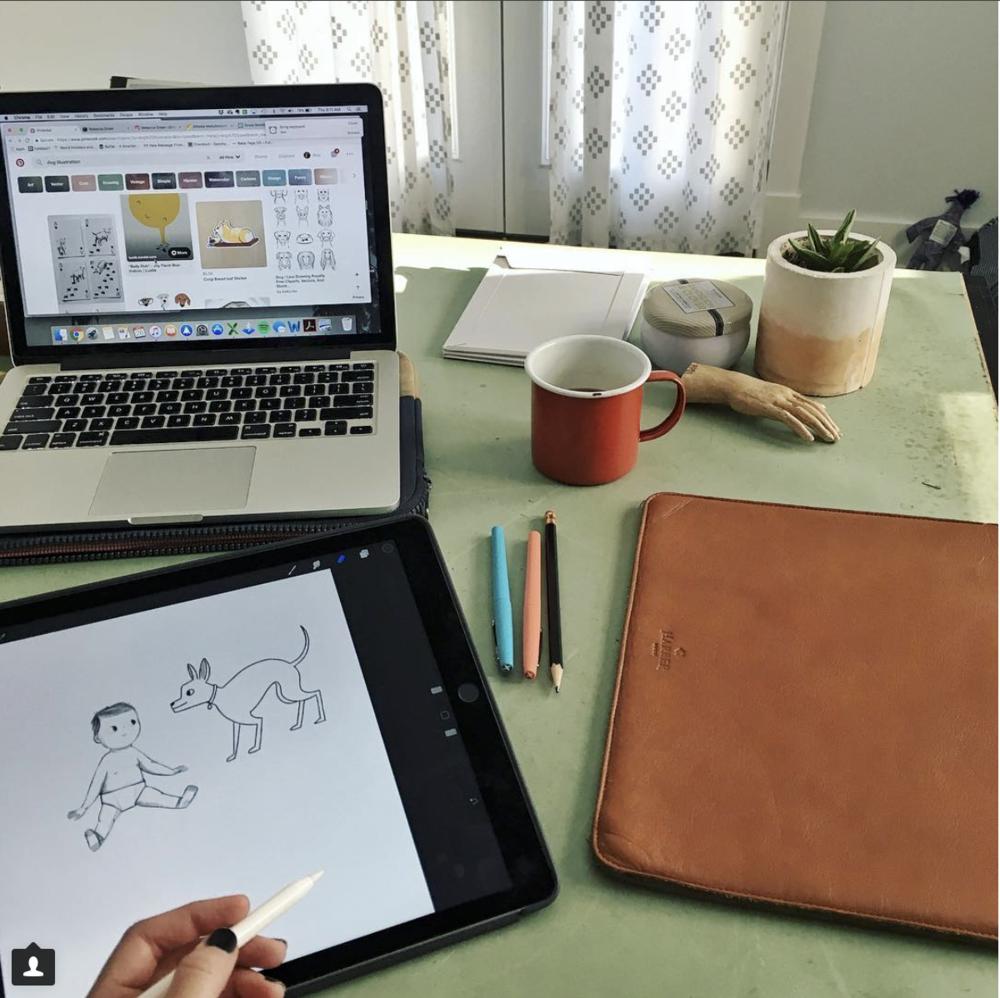 Ava Puckett drawing on her iPad in her studio