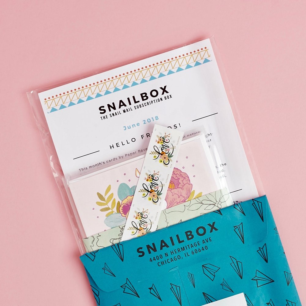 Receive & Unwrap (Snailbox mailer with contents showing)