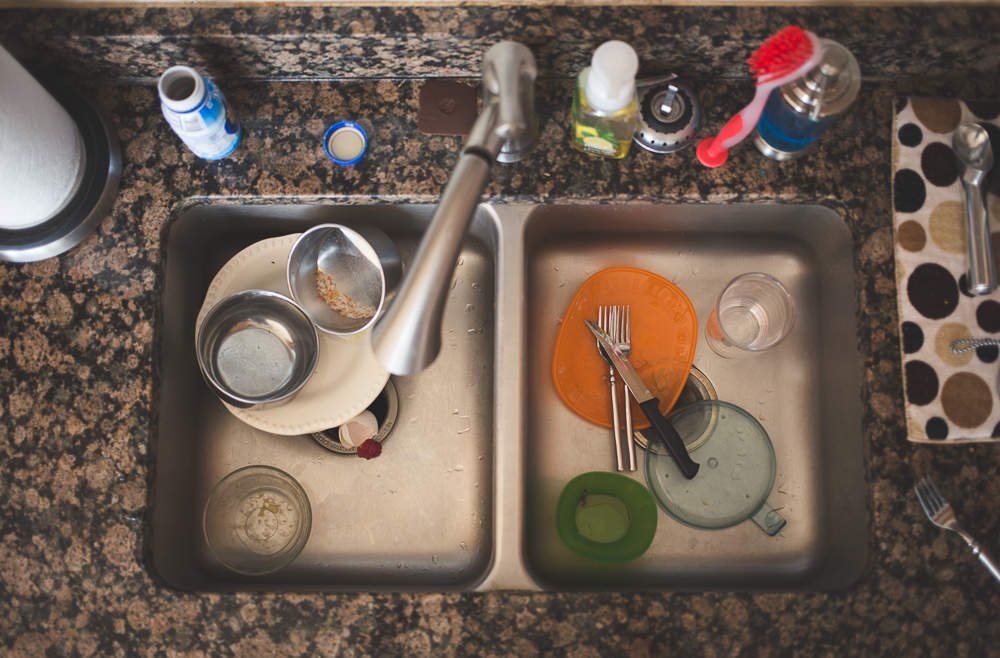 Dishes in the sink during an in home family documentary photo session near Annapolis, Maryland.