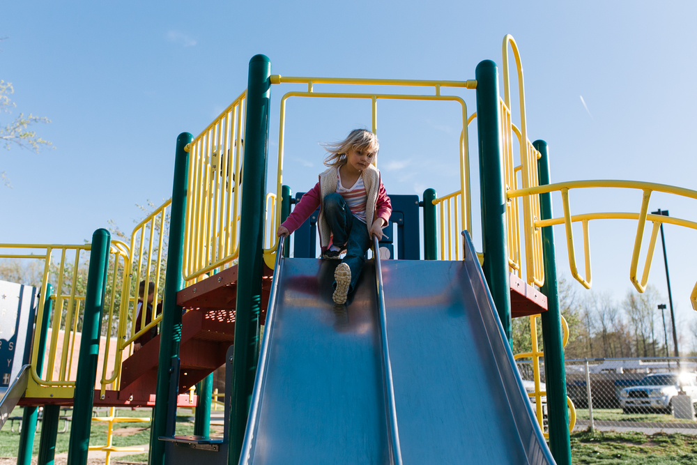 child playing on the playground | annapolis maryland | candid photographer