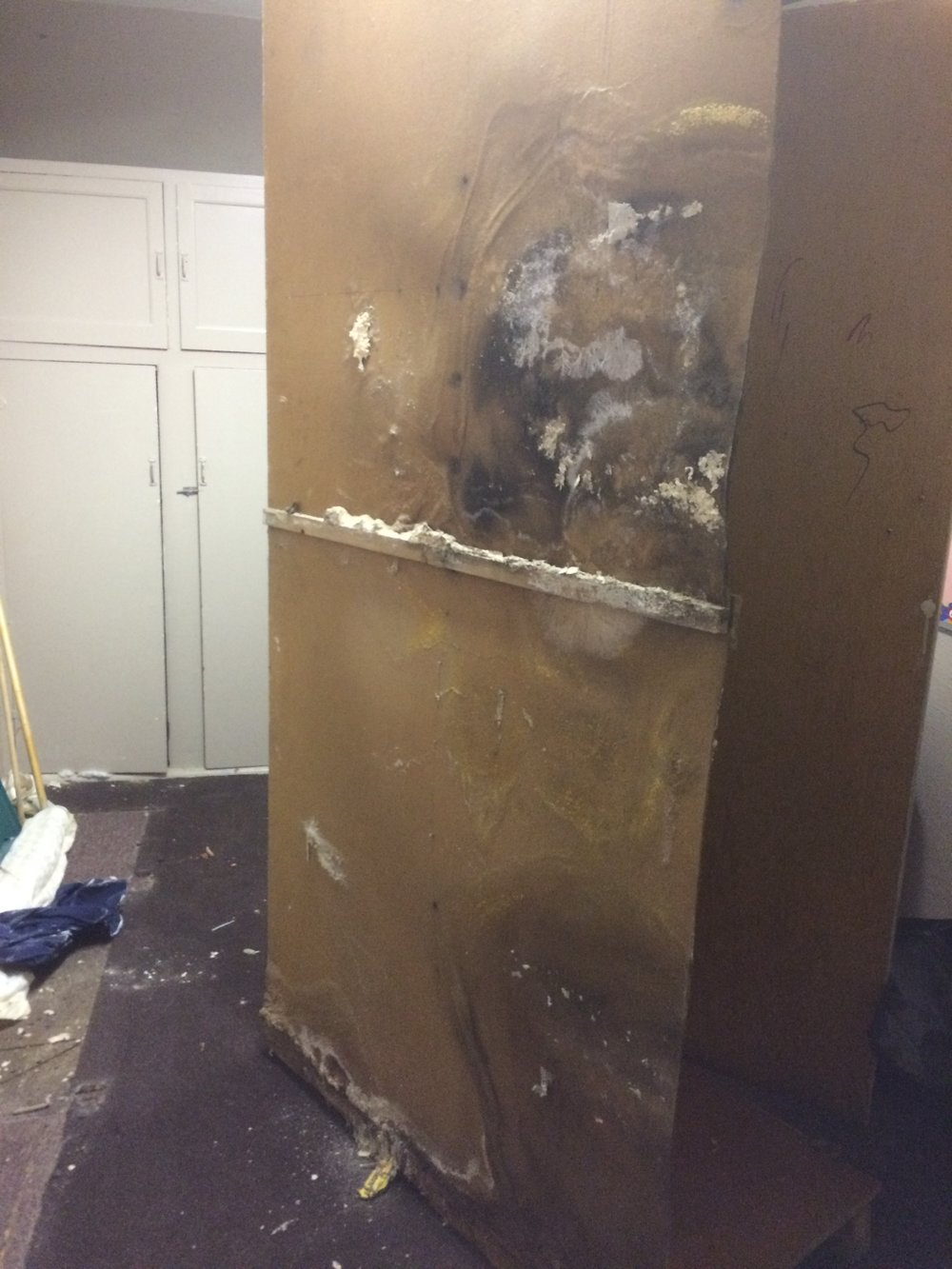 Mould and mildew had penetrated into the cabinets: Supplies stored inside were so infected, they, too, had to be thrown away. Here you can see seepage was at both the higher groundlevel outside and at the footing level on the bottom.