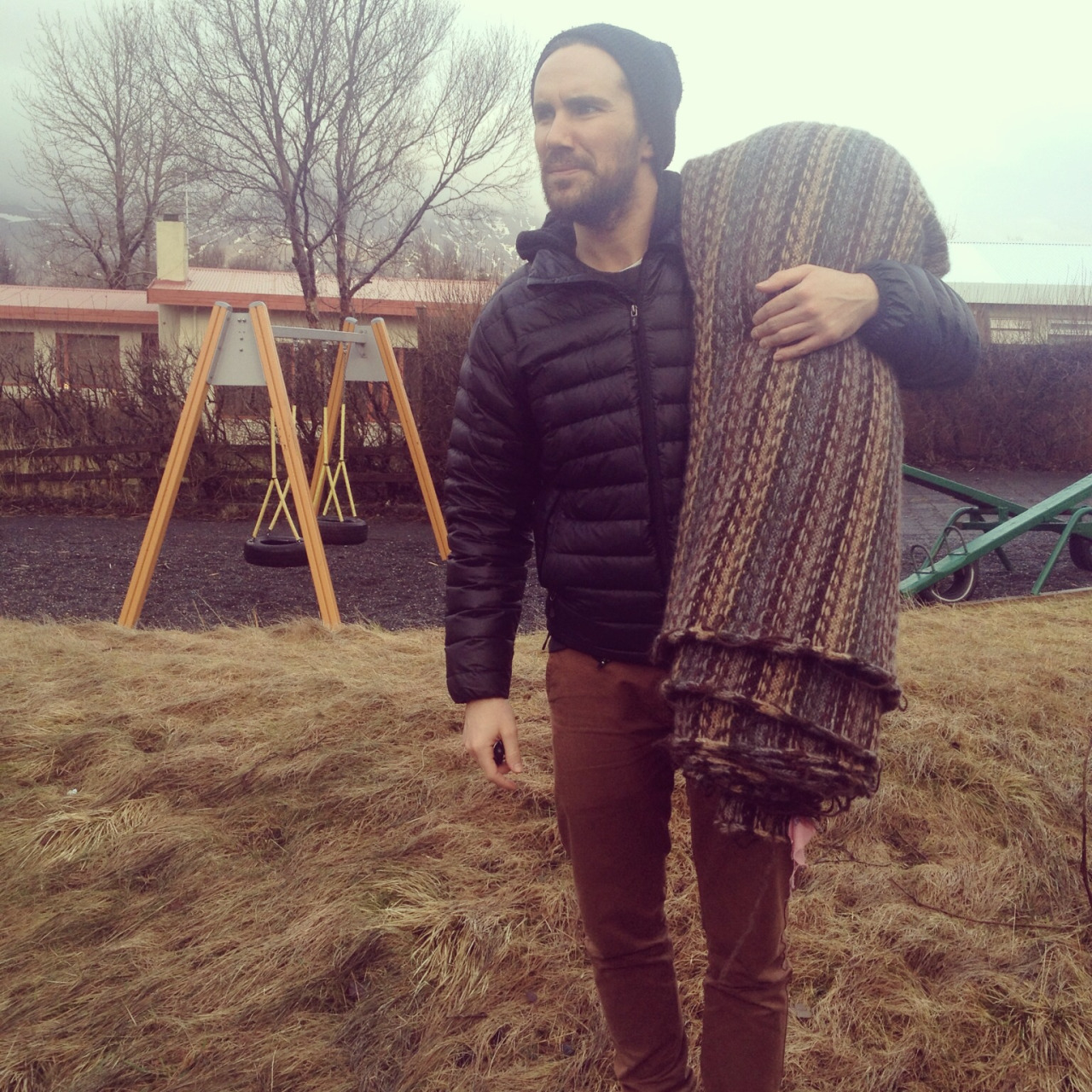 Oh don't mind this fellow, he's just carrying 6 meters of Icelandic wool. Hidden is the design of some new goods we've been working on…