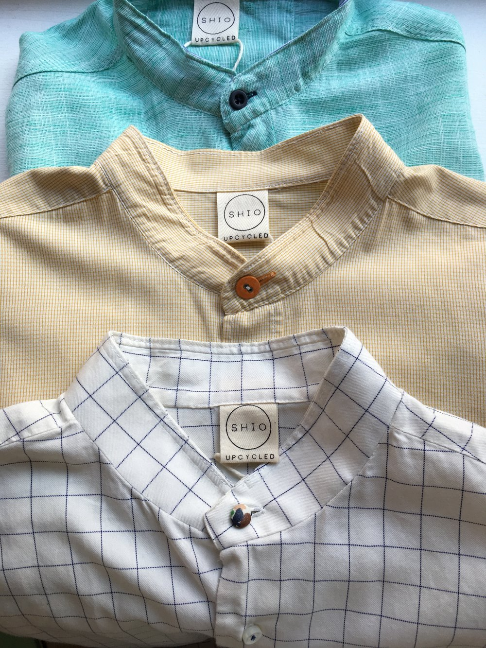 Upcycled Mens Shirts:  I remove the collar, sometimes resize them, add a contrast button and thread.