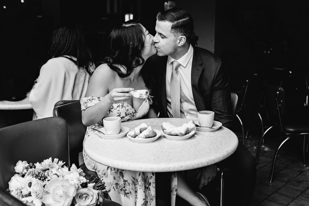 French Quarter Elopement Couple Eats Beignets at Cafe Du Monde New Orleans Wedding Photographer Ashley Biltz Photography2.jpg