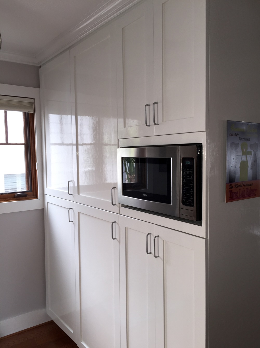KITCHEN CABINETS — BENJAMIN MOORE ADVANCE & CLEAR COAT, BRUSHED/ CROWN MOULDING — PAINTED WHITE