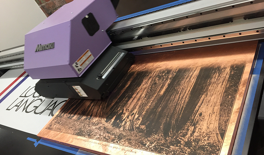 Large Format Flat Bed Press in Action - we can print on anything and usually do...  Above is a wood panel hand finished with bronze leaf, a vintage photograph of Yosemite, circa 1888.