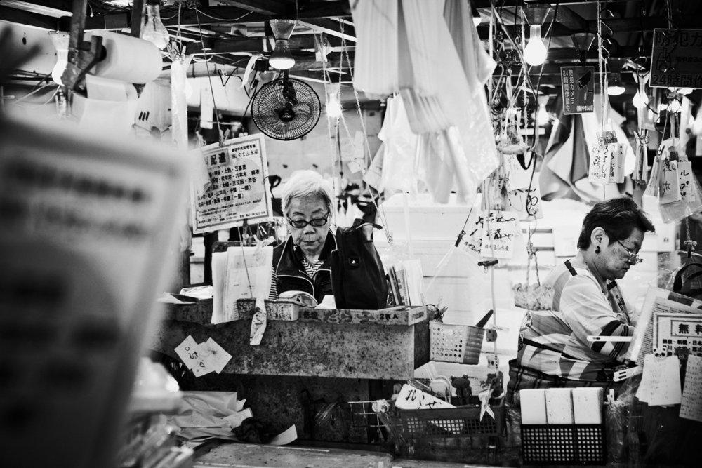 Vendors in tsukiji fish market Tokyo