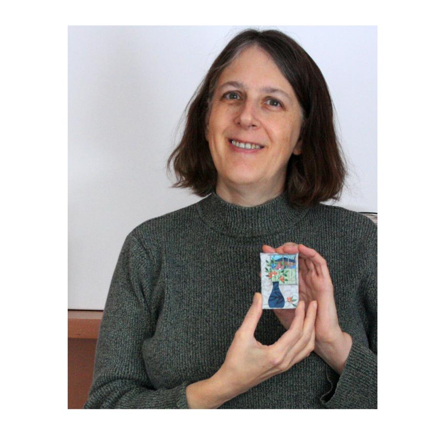 Me holding a refrigerator magnet.jpg
