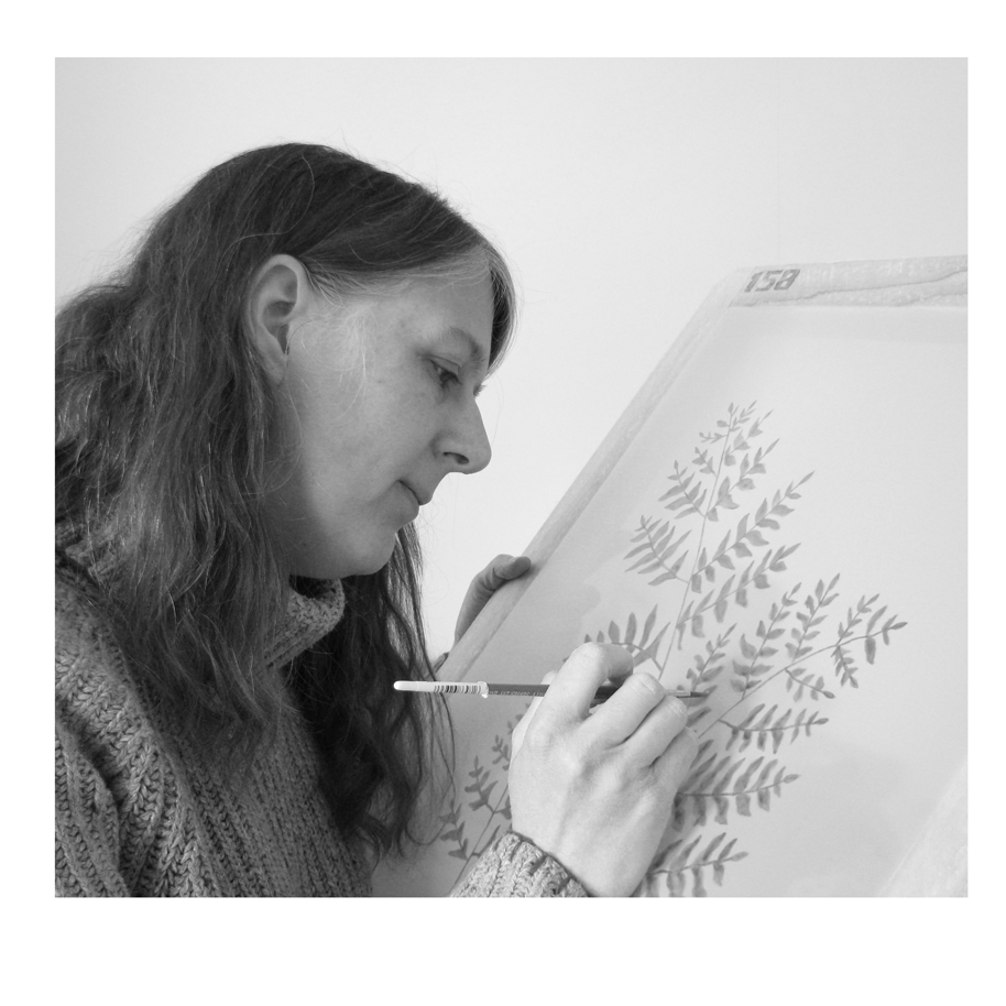 Me drawing a fern design on a screen (2010).