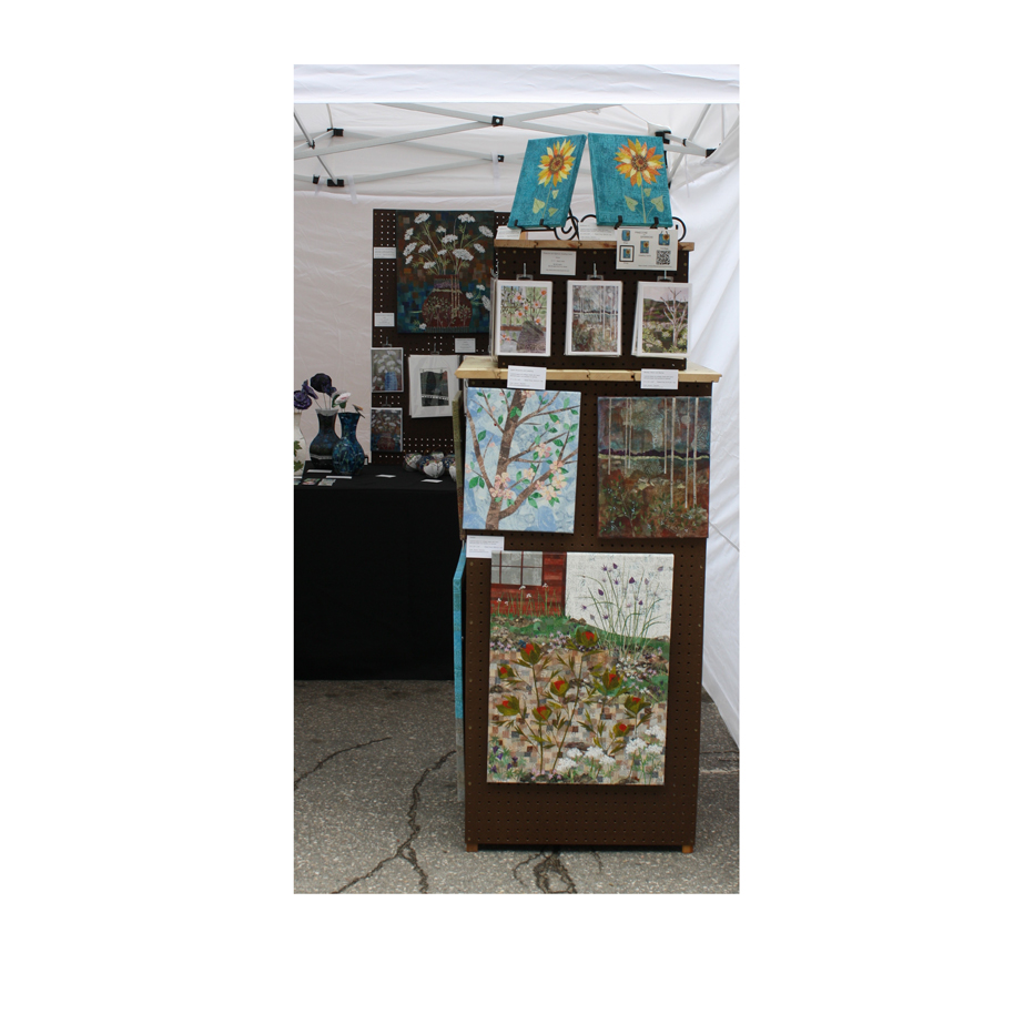 Pinecone and Sparrow display stand with greeting cards, matted collage, and wall art collage.