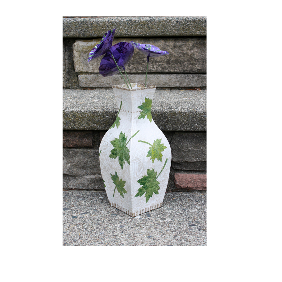 Leaves Vase with Purple Flowers. Layered paper collage on papier mache. Available at the Winthrop Sidewalk Art Festival.