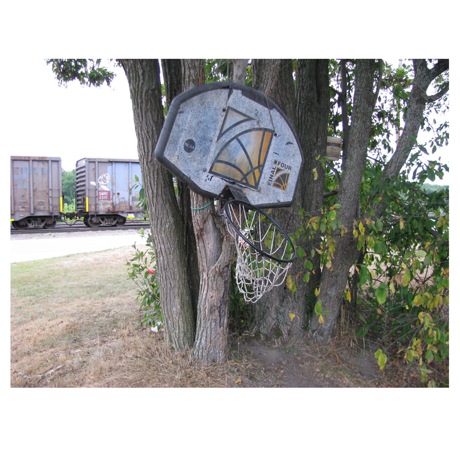 Basketball Hoop with train in the background.