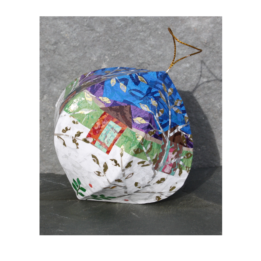 Collage and papier mache ornaments. Available for purchase here.