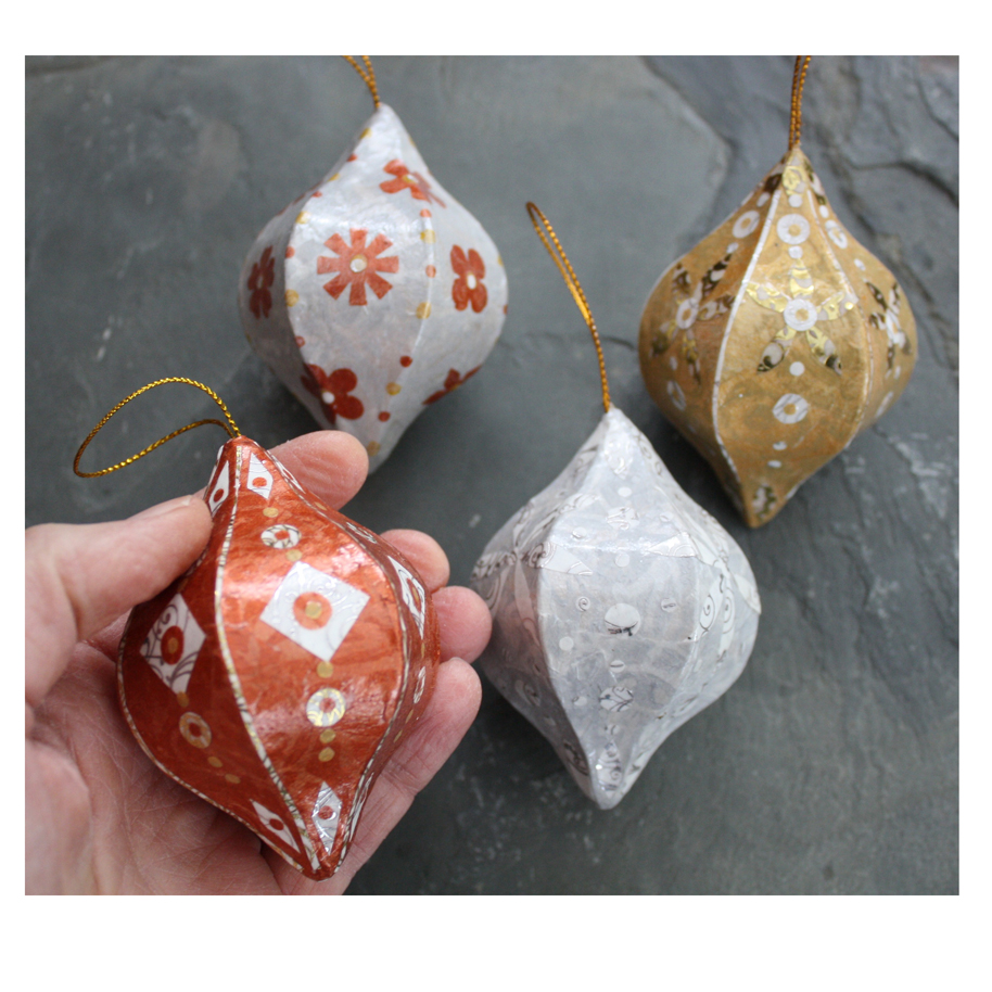 Four Ornaments. Layered paper collage on papier mache.  Available here .